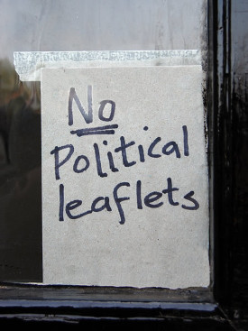 A hand-written sign that reads 'No Political Leaflets'.